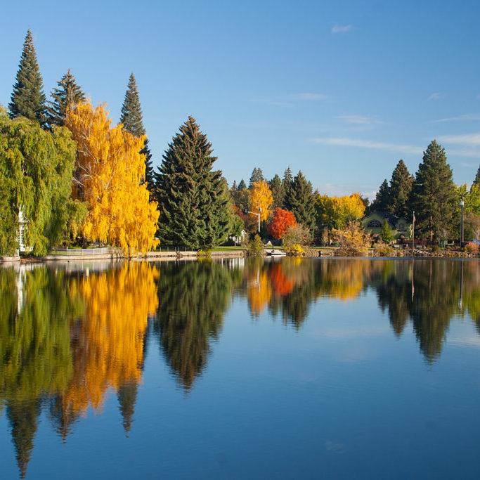 """Autumn reflection of trees on Mirror Pond, Bend, Oregon"""